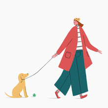 Woman Walking Dog With Ball