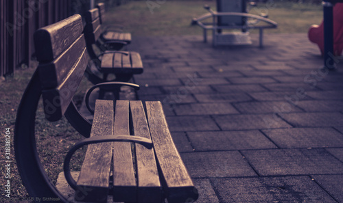 Fotografering Empty Wooden Benches On Footpath In City