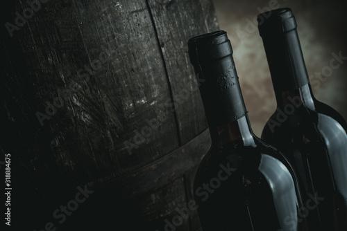 Fototapeta red wine bottles and barrel - desaturated style image obraz