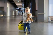 Blonde Toddler Boy With Family, Traveling With Airplane, Running At The Airport