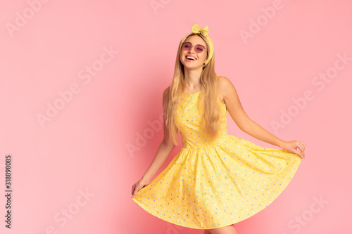 Fotografía Cheerful young blonde woman dancing at pink studio