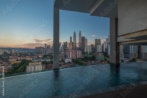 Buildings By Swimming Pool Against Sky During Sunset Canvas Print