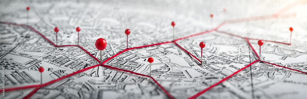 Fototapeta Routes with red pins on a city map. Concept on the  adventure, discovery, navigation, communication, logistics, geography, transport and travel topics.