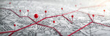Routes with red pins on a city map. Concept on the  adventure, discovery, navigation, communication, logistics, geography, transport and travel topics.