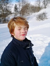 Boy With Closed Eyes On Snowy ...