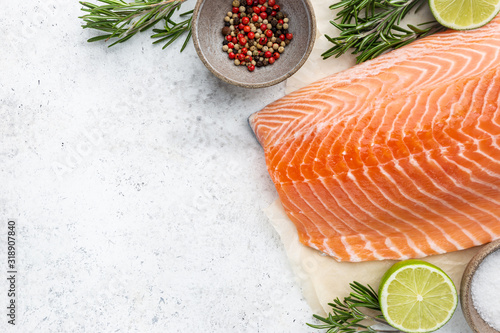 Fresh raw salmon or trout sea fish fillet with spices and herbs on white backgro Fototapeta