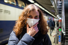 Woman Wearing Surgical Mask In...