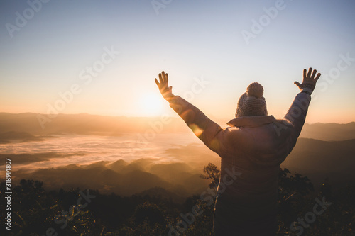 Obraz na plátně Women praying at sunset mountains raised hands Travel Lifestyle spiritual relaxation emotional concept, Freedom and travel adventure