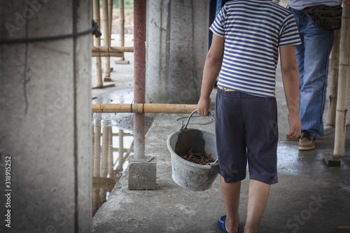 Photo The concept of illegal child labor, Children are forced to work construction