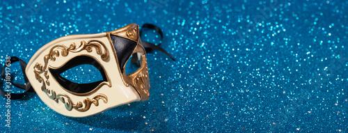 Fototapeta Venetian carnival mask with blue glitter background obraz