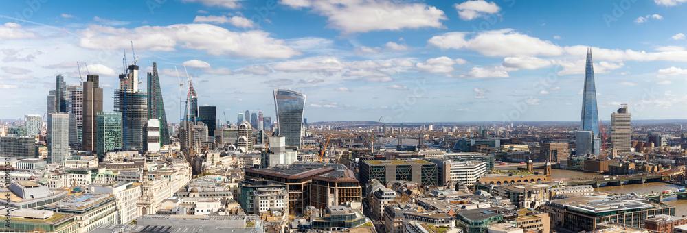 Fototapeta Aerial View Of Modern Buildings In City Against Sky