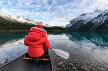 Man Traveler Holding Paddle On...