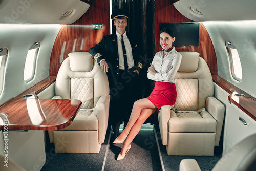 Photo Pilot and flight attendant in private jet