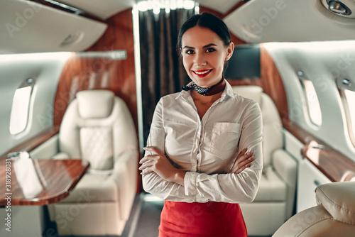 Valokuva Flight attedant in private jet