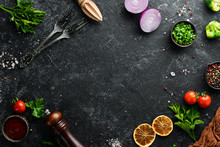 Black Food Background. Vegetables And Spices On Black Background. Top View. Free Space For Your Text.