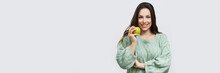 Young Woman Holding Apple Isolated On White Wall Background. Weight Loss And Diet Concept. Banner Crop For Copy Space