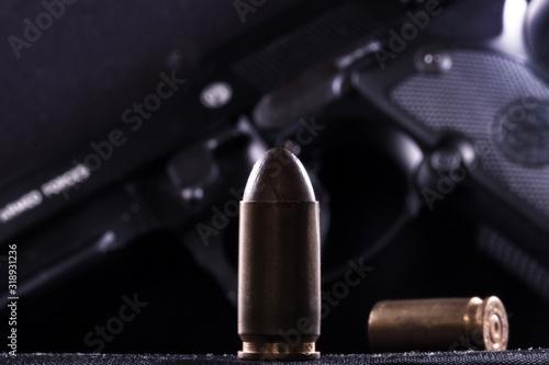 Fototapeta Close-Up Of Bullets And Gun