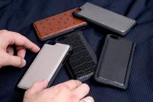 Leather Phone Case Craftsmanship Work On The White Background.