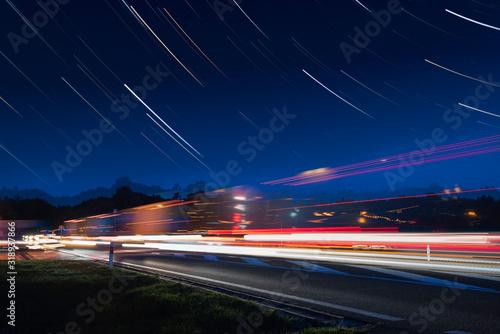 Photographie Speed Traffic - light trails on motorway