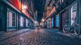 Empty Street In Illuminated City At Night