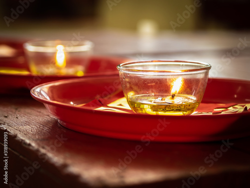 Candles in glass cups and joss papers Canvas Print