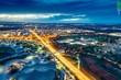 Leinwandbild Motiv HIGH ANGLE VIEW OF ILLUMINATED STREET AMIDST BUILDINGS IN CITY AT NIGHT