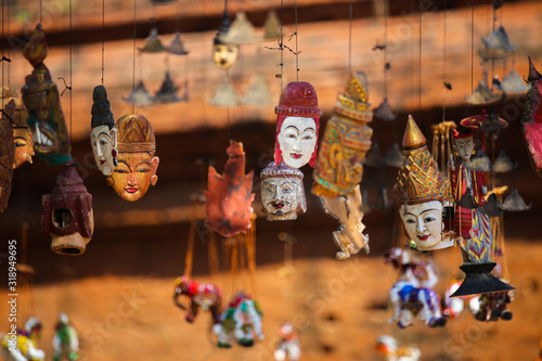 фотография Bright souvenirs and puppets on the market in the ancient pagoda in Bagan, Myanm