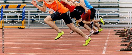 start sprint men runners run 100 meters at stadium Tapéta, Fotótapéta