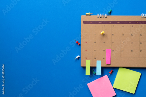 close up of calendar on the blue table, planning for business meeting or travel Canvas Print