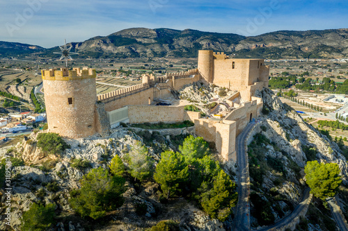 Canvas Print Aerial view of Castalla castle in Valencia province Spain with donjon towering o