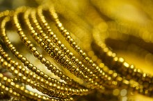 Close-Up Of Golden Jewelries On Table