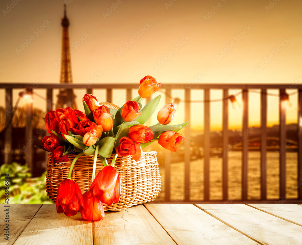Fototapeta Wooden table of free space and blurred background of Paris city.Sunny day and orange color of sunset.