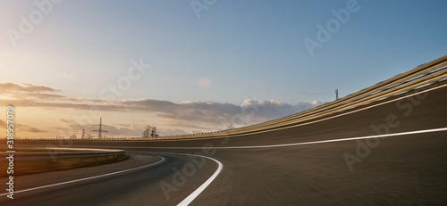 Canvastavla Race Car / motorcycle racetrack on a sunny day.