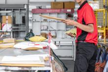 Thai Young Postal Man Is Sorti...