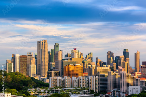 BUILDINGS IN CITY AGAINST CLOUDY SKY - fototapety na wymiar