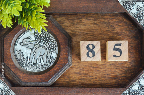 Cuadros en Lienzo Number 85, Numbercube design with wooden board for background.