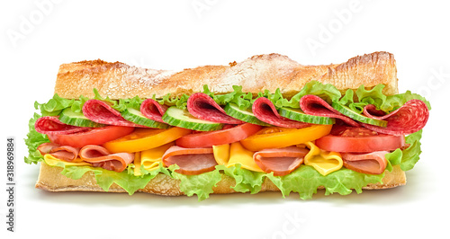 Fresh submarine sandwich with ham, cheese, salami, tomato, lettuce salad, cucumber isolated on white. Colorful tasty baguette homemade large sub sandwich with vegetables. Fast food concept