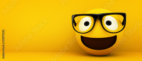 Photo happy emoticon with glasses