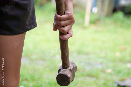 Tablou Canvas Close-Up Of Hand Holding Hammer