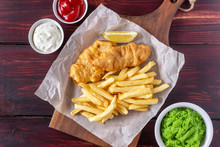 Fish And Chips On A Wooden Bac...
