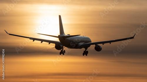 Airplane landing to sunset
