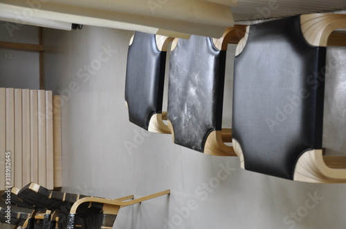 Obraz High Angle View Of Empty Chairs In Row On Tiled Floor - fototapety do salonu