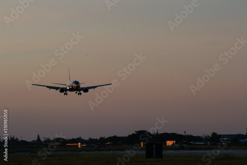 Fototapety, obrazy: Airplane Landing On Runway During Sunset