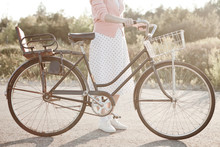 Retro Woman With Bicycle Outsi...