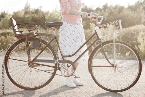Photo Retro Woman with Bicycle Outside, Healthy Living, Vintage Nostalgia