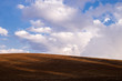 colors and shades of a plowed hill