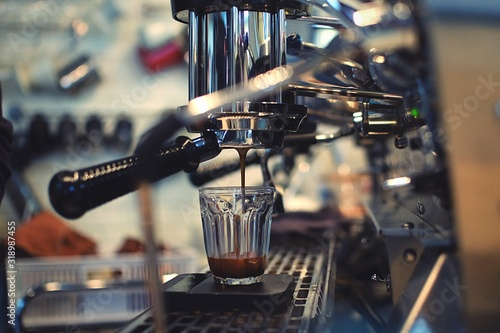 Fototapeta Close-Up Of Espresso Maker Pouring Coffee In Cup At Cafe