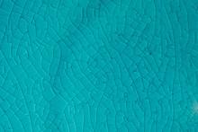 Blue Background. Cracks In Cer...