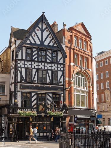 George Pub in Great Portland Street, West London in England. People around Wall mural