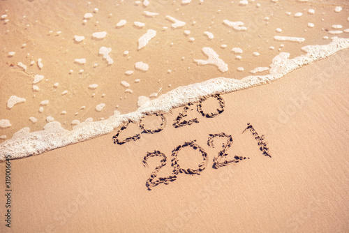 New Year 2021 replace 2020 on the sea beach concept.